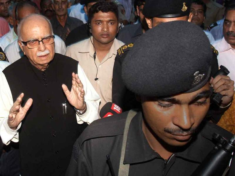 Senior BJP leader LK Advani leaves after visiting injured persons of high court blast at RML hospital in New Delhi.