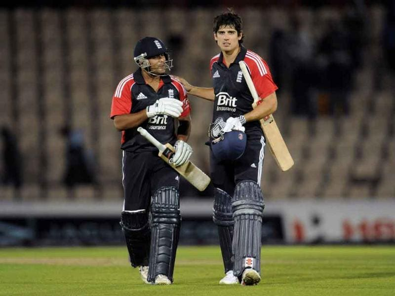 England's captain Alastair Cook (R) and Samit Patel leave the field after England defeated India in the second one-day international cricket match at the Rose Bowl cricket ground in Southampton, England.