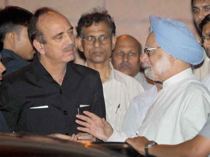 Prime Minister Manmohan Singh talks to health minister Ghulam Nabi Azad after visiting the injured persons of the High Court blast, at RML hospital in New Delhi.