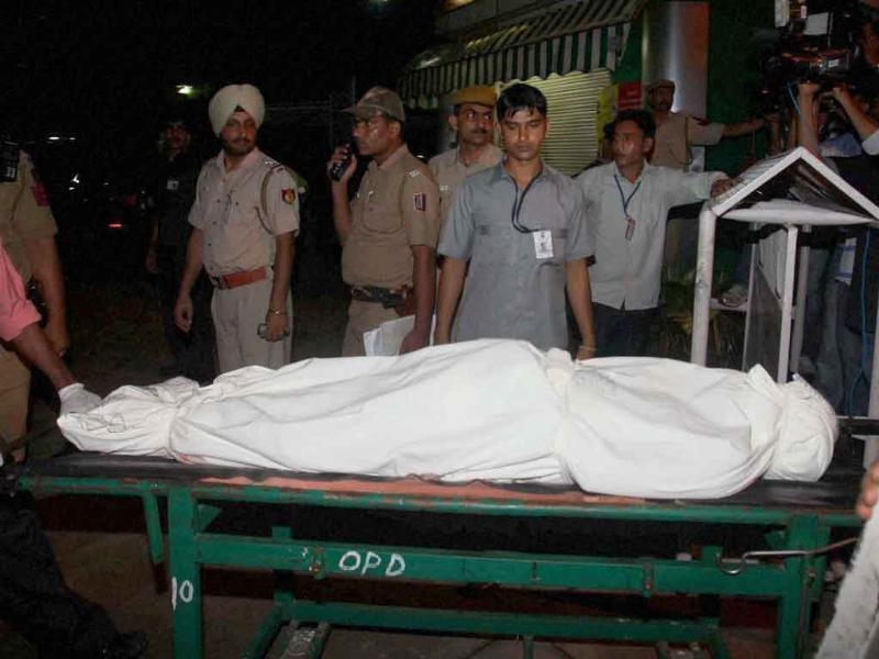 Body of a victim of the high court blast being taken to a mortuary at the RML Hospital in New Delhi.