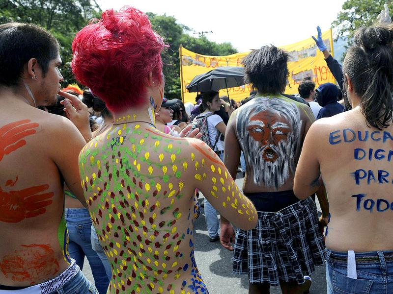 Students with their bodies painted take part in a demonstration in Medellin, Antioquia department, Colombia, as part of a national march in defense of public education.