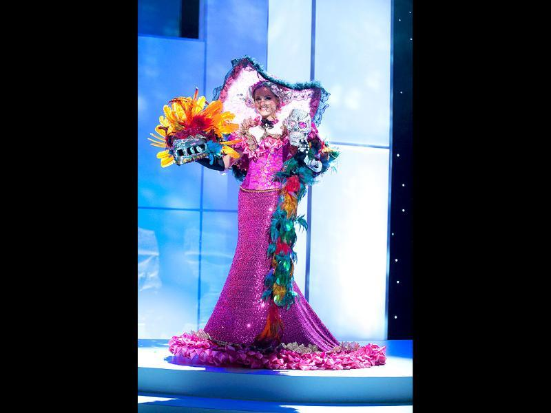 Miss Mexico is brightly bizarre with the skulls and feathers as she pre-tapes her National Costume onstage at Credicard Hall.