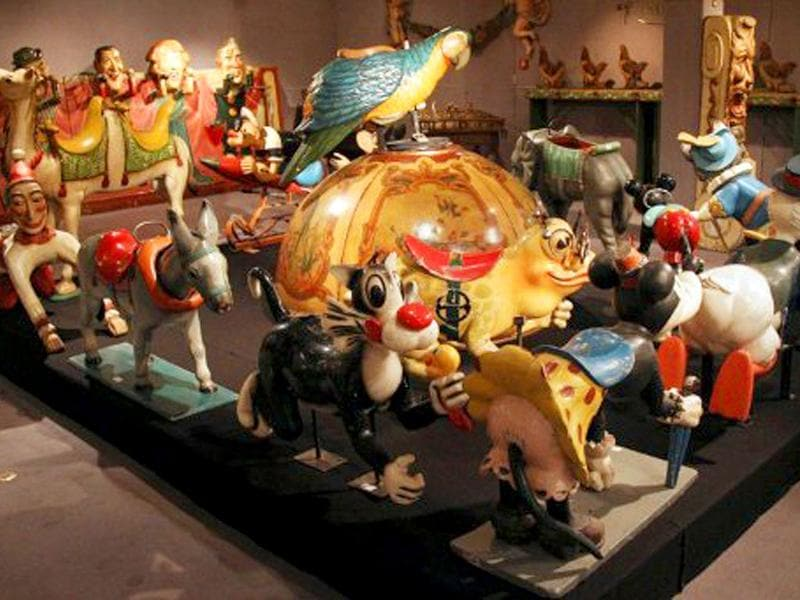 A picture at Cornette Saint-Cyr auction house in Paris, shows painted and wooden animals taking part of roundabouts, displayed prior to the auction