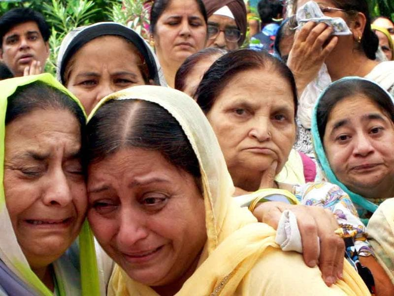 Relatives grieve the death of Sardar Inder Singh who died in the blast at the Gita Colony Gurudwara in New Delhi.