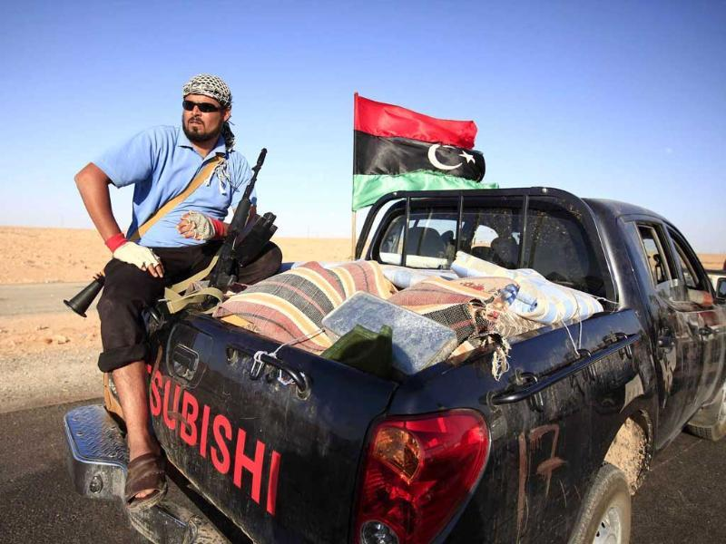An anti-Gaddafi fighter from the Warfallah tribe prepares to advance to the town of Bani Walid, currently held by pro-Gaddafi forces, in southeast Tripoli.