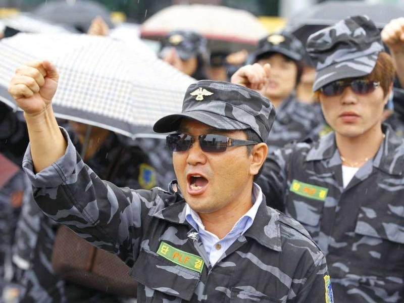 Members of the North Korean People's Liberation Front, which consists of former soldiers in the North's People's Army who defected and are now living in the South, chant anti-North Korea slogans near the demilitarized zone separating the two Koreas in Paju, north of Seoul.