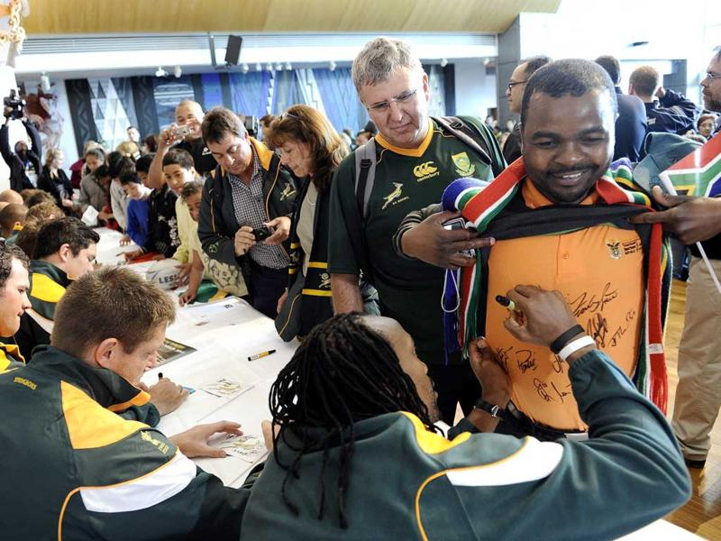 Supporters of the South African Rugby team queue to get autographs from the Springbok's team.