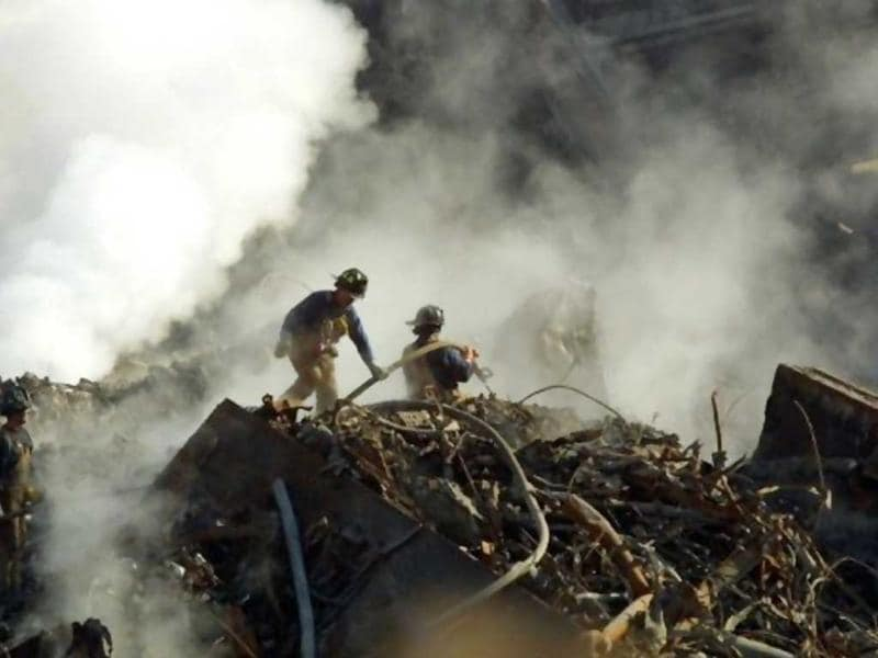 Workers sift through the still-smouldering rubble of the terrorist destroyed World Trade Center 12 October 2001 in New York. File photo.