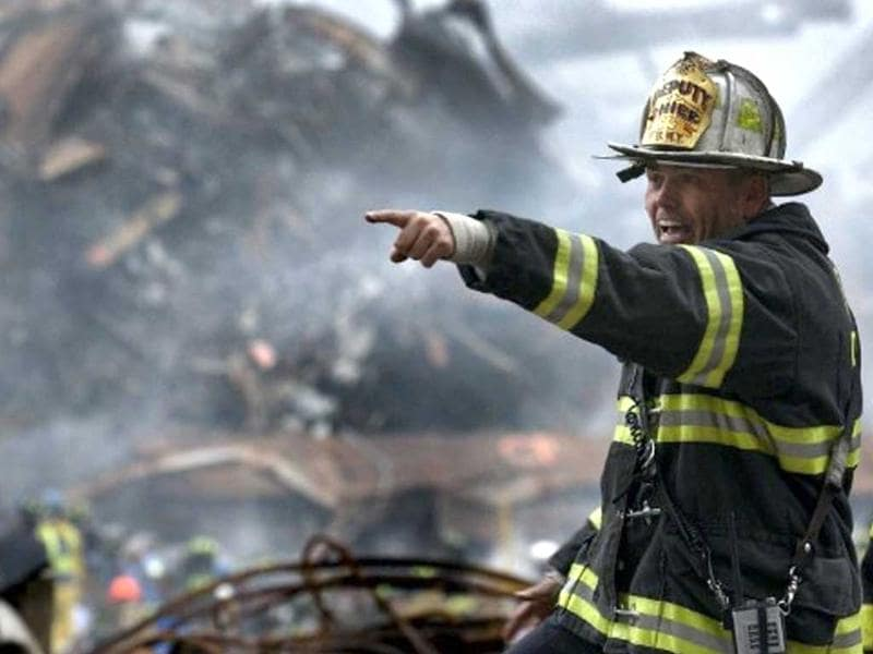 This photo released by the US Navy on 18 September 2001 shows Retired Division 13 Department Chief Joseph Curry shouting orders amid the devastation that was once the World Trade Center in New York City 14 September 2001. File photo
