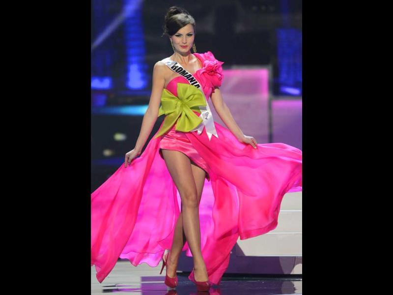 Miss Romania is hard to miss in that bubblegum pink and neon green gown.