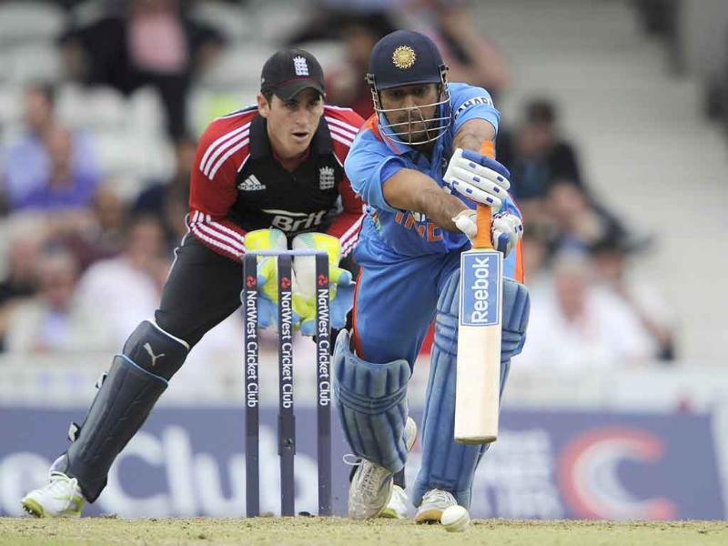 Mahendra Singh Dhoni hits a ball from England's Graeme Swann during their one day international cricket match at the Oval cricket ground, London.
