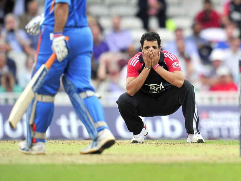 England's Ravi Bopara shows his disappointment as Mahendra Singh Dhoni hits another boundary during the third one day cricket match between England and India at The Oval, London.