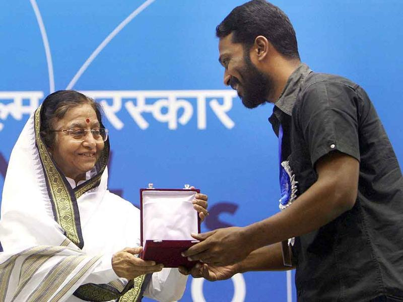 President Pratibha Patil presents Best Direction award to Vetri Maaran for his film Aadukalam during the 58th National Film Awards Function in New Delhi.
