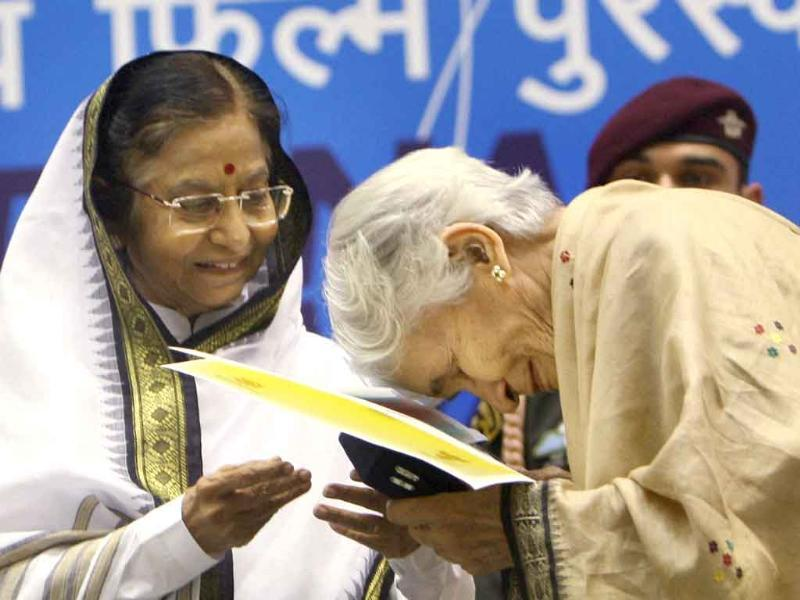 President Pratibha Patil presents the Best Book on Cinema award to Vijaya Mulay for her book From Rajahs and Yogis to Gandhi and Beyond during the 58th National Film Awards Function in New Delhi.