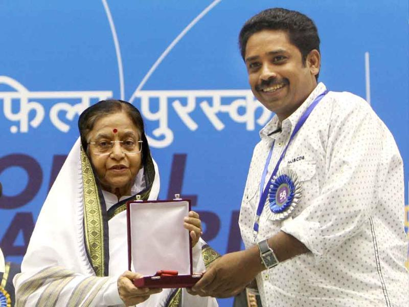 President Pratibha Patil presents Best Tamil Film Award to director Seenu Ramasamy for his film 'Thenmerkku Paruvakkatru' during the 58th National Film Awards Function in New Delhi.
