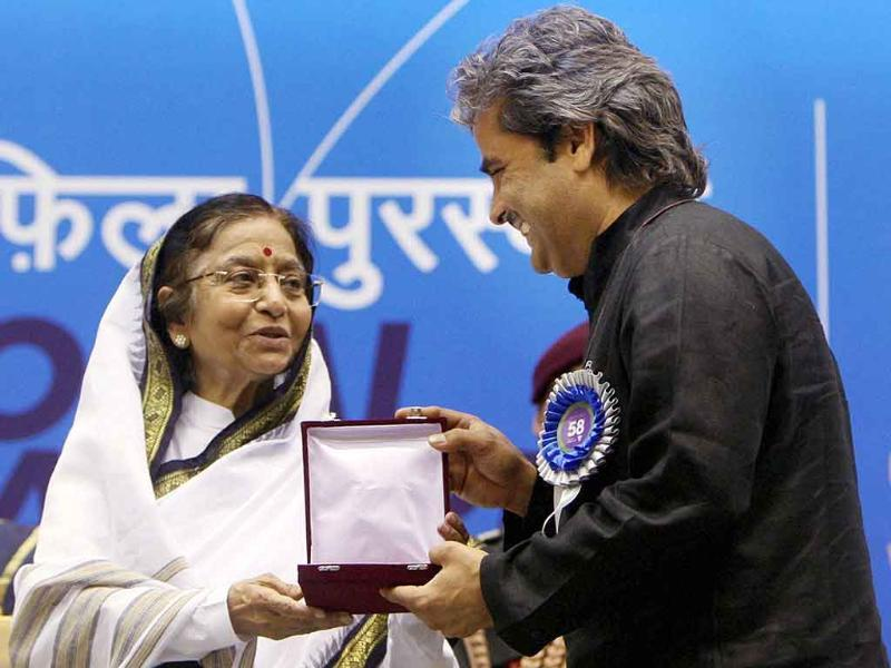 President Pratibha Patil presents the Best Music Direction (Songs) award to Vishal Bhardwaj during the '58th National Film Awards Function' in New Delhi.
