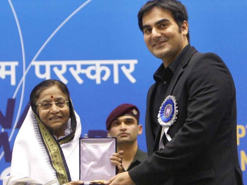 President Pratibha Patil presents the award for Best Popular Film providing wholesome entertainment to Producer-actor Arbaaz Khan for his film Dabangg during the '58th National Film Awards Function' in New Delhi.