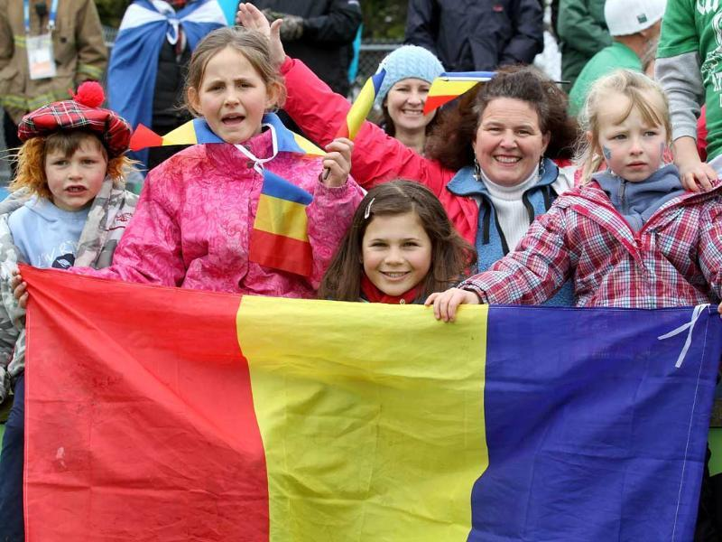Romanian fans hold their flag during the 2011 Rugby World Cup pool B match Scotland vs Romania at the Rugby Park stadium in Invercargill.