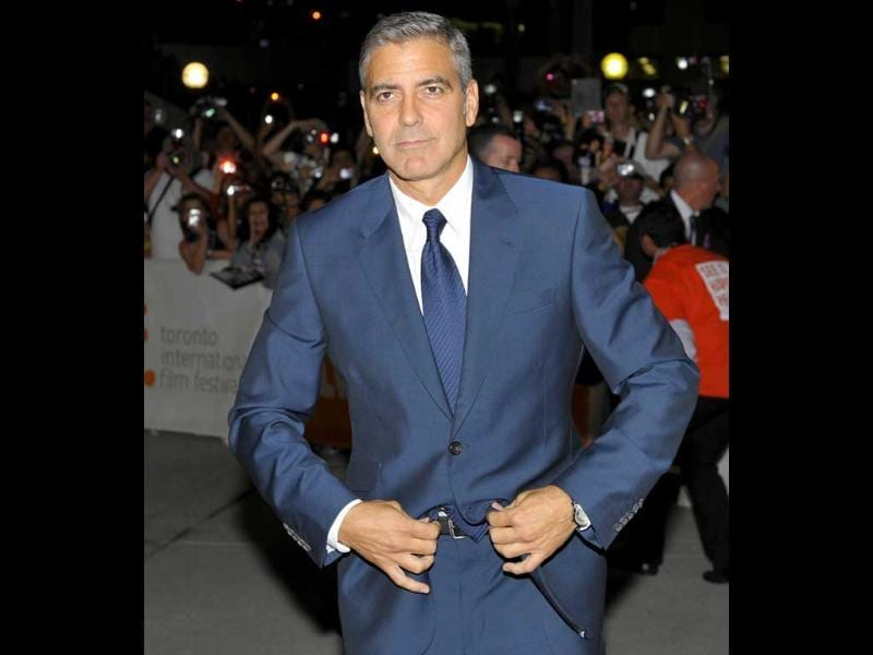 Director and actor George Clooney poses at the gala presentation for his film The Ides Of March at the 36th Toronto International Film Festival.