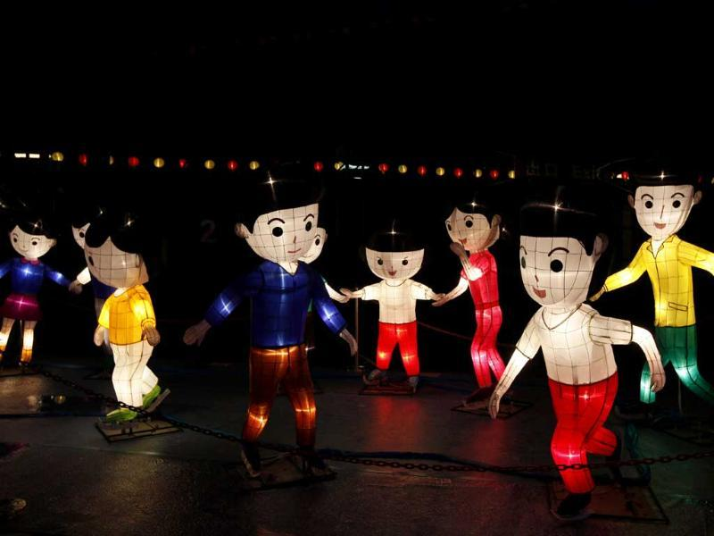 Children-shaped lanterns are displayed as part of the celebration of the upcoming Mid-Autumn festival in Hong Kong.