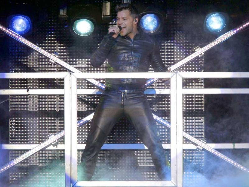 Puerto Rican pop singer Ricky Martin performs during his M.A.S. Tour in Asuncion.
