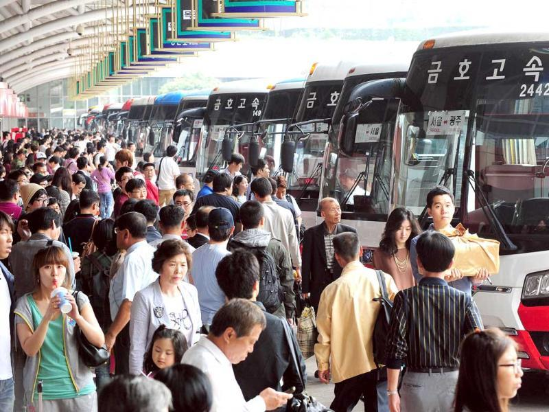 South Korean passengers queue at a bus termial in Seoul as they travel to their home towns and villages across the country to visit relatives during the Korean Chuseok holiday, which lasts from September 11 to 13.