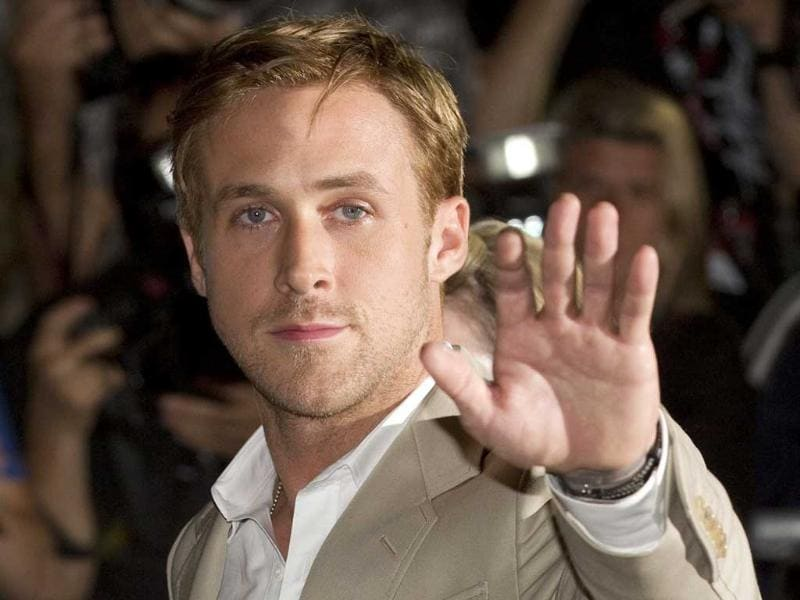 Actor Ryan Gosling waves as he arrives for the Gala Premiere of his film The Ides of March at the Toronto International Film Festival.