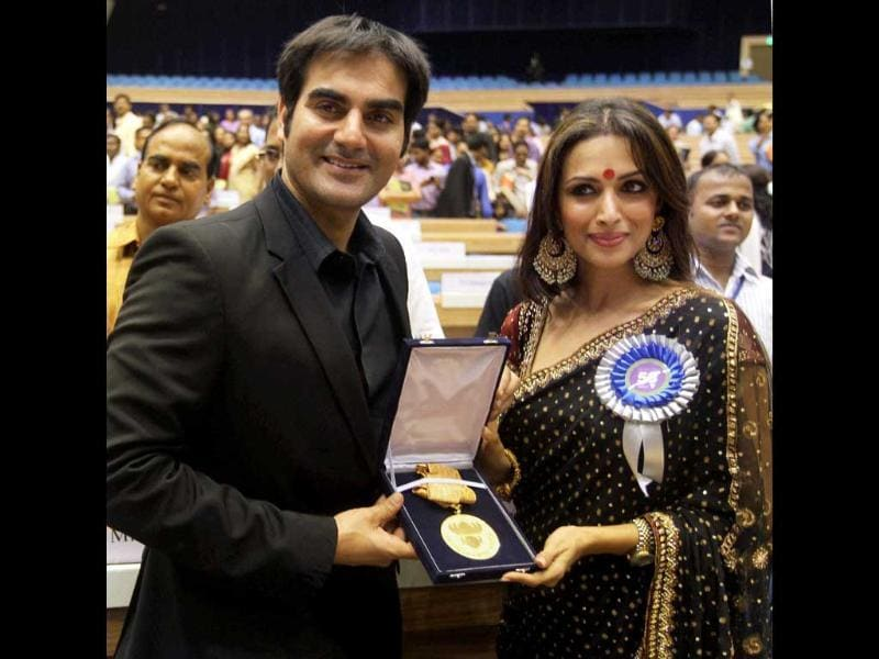 Dabangg producer duo Arbaaz Khan and 'Munni' Malaika Arora flaunt their national award for best popular film providing wholesome entertainment during the 58th National Film Awards function. Check out memorable moments from the event.