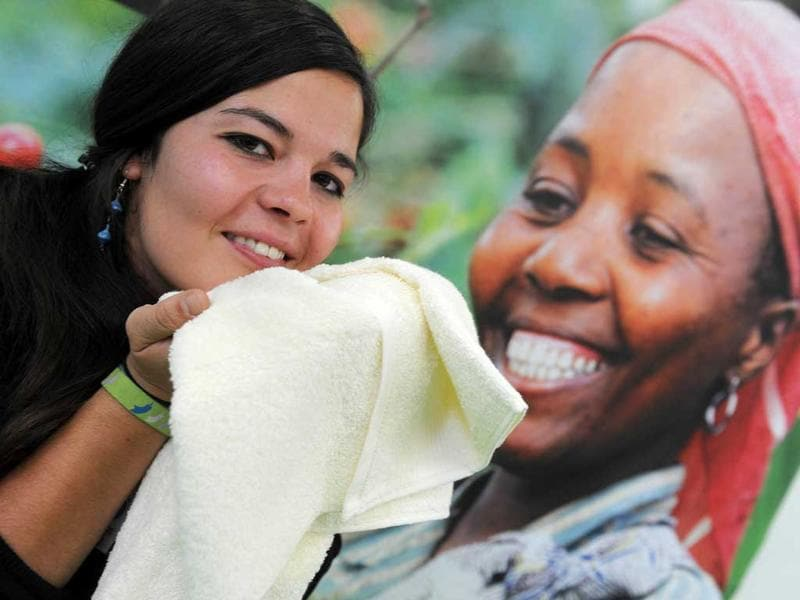 A woman holds a cotton towel produced in Africa in Dortmund, western Germany, during the