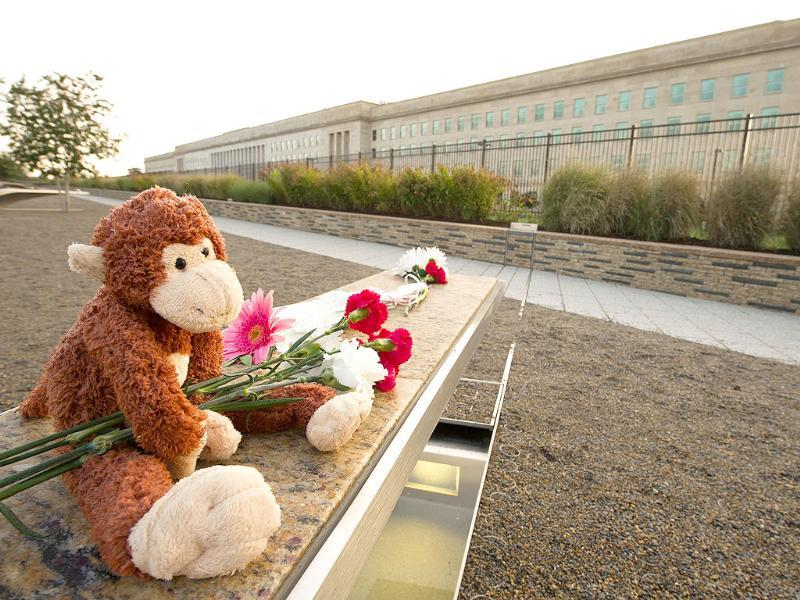 Mementos are left at a 9/11 memorial bench at the Pentagon in Washington, DC.