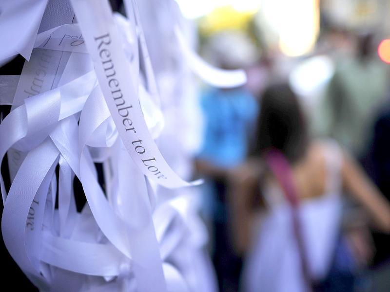 Thousands of white ribbons bearing the words Remember to Love, part of an arts project marking 10th anniversary of the 9/11 terrorist attacks, are seen outside St. Paul's Church in downtown Manhattan.