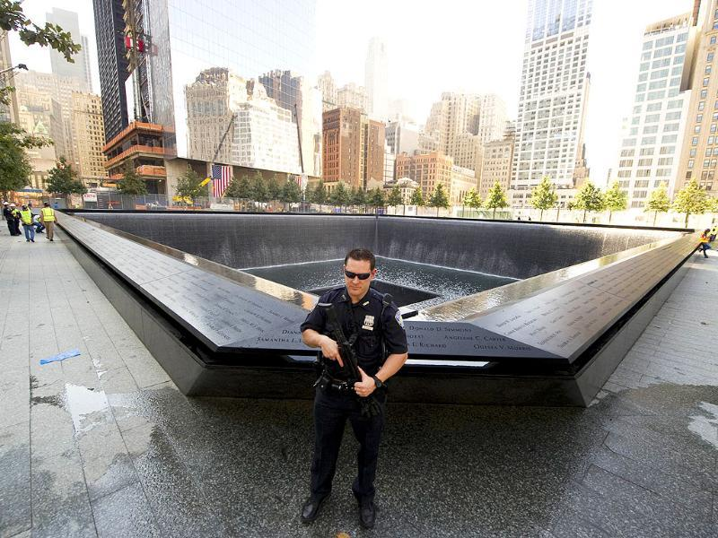 A Port Authority officer stands guard near the south reflecting pool of the World trade Center Memorial in New York.
