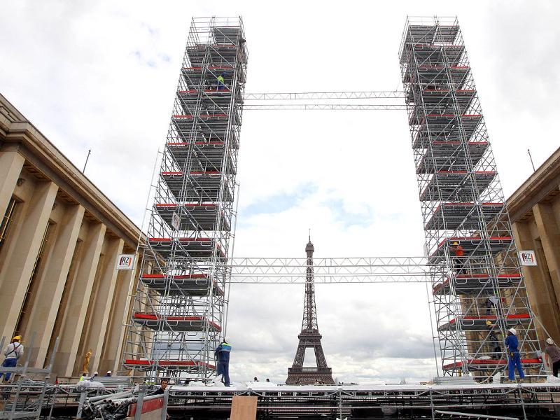 A picture shows the construction of a replica of the Twin Towers destroyed in the September 11 attacks and the Eiffel tower on September 9, 2011 in Paris, to mark the tenth anniversary of the attacks.