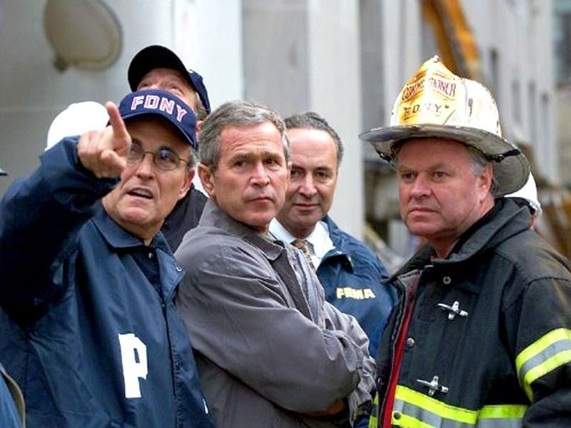 The then US President George W Bush surveys the damage at the site of the World Trade Center with New York Mayor Giuliani and a New York City Fire Department Official 14 September 2001 in New York. File photo