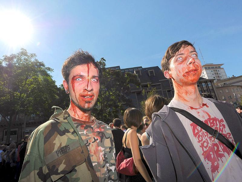 People dressed up as zombies take part in the Zombie Walk event on September 10, 2011 in the French eastern city of Strasbourg, before the opening of the fourth edition of the European Fantastic Film festival.