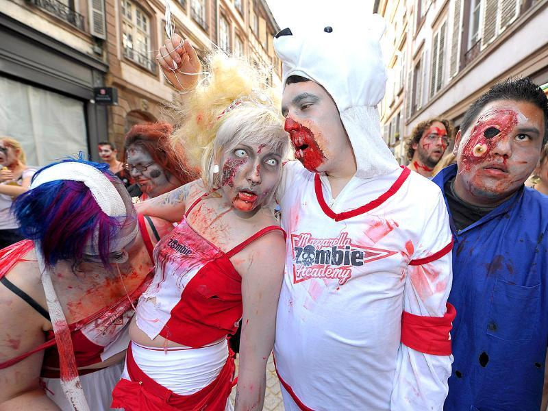 People dressed as zombies take part in the Zombie Walk event.