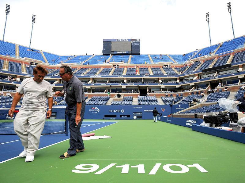 Event Staff look over the stencil prior to the start of the Men's semifinal 2011 US Open match.
