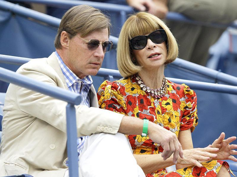 Vogue editor-in-chief Anna Wintour, right, waits with a guest for the start of a semifinal match at the US Open tennis tournament in New York.