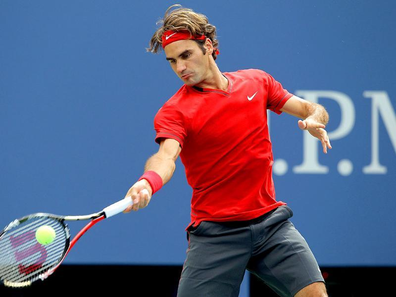 Roger Federer of Switzerland hits a return against Novak Djokovic of Serbia during the Men's semifinal 2011 US Open match.