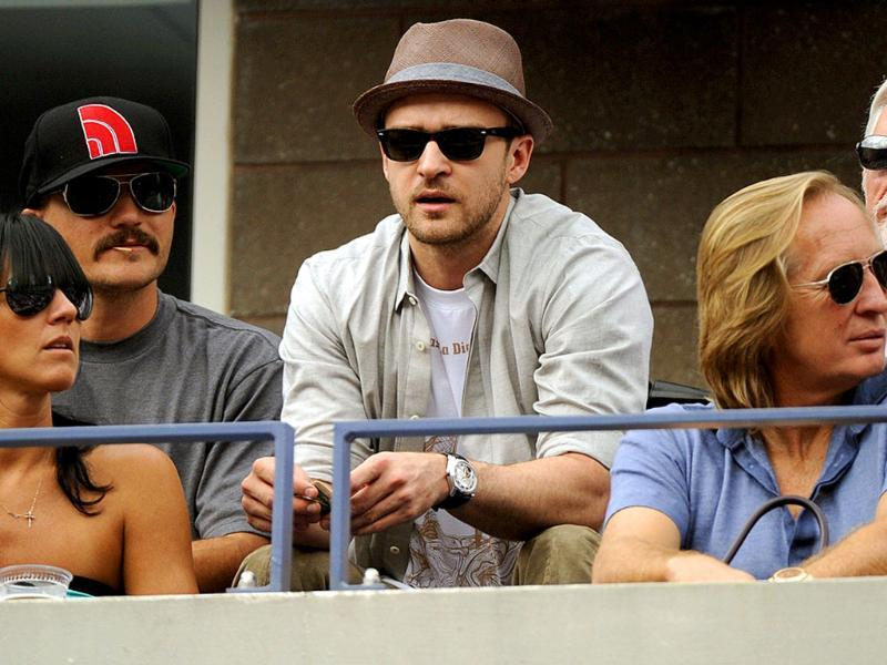 Singer Justin Timberlake watches the men's semifinal match between Novak Djokovic and Roger Federer during the 2011 US Open.