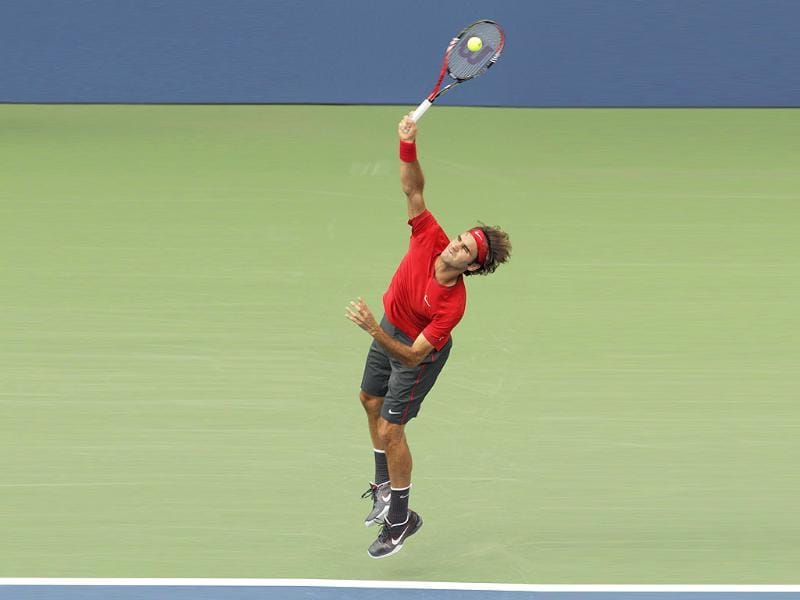Roger Federer serves to Novak Djokovic during a semifinal match at the US Open tennis tournament in New York.