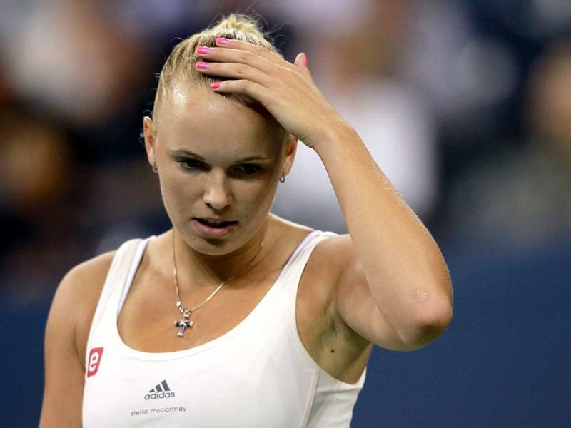Caroline Wozniacki of Denmark reacts against Serena Williams of the United States during the semifinal of the 2011 US Open at the USTA Billie Jean King National Tennis Center in New York City.