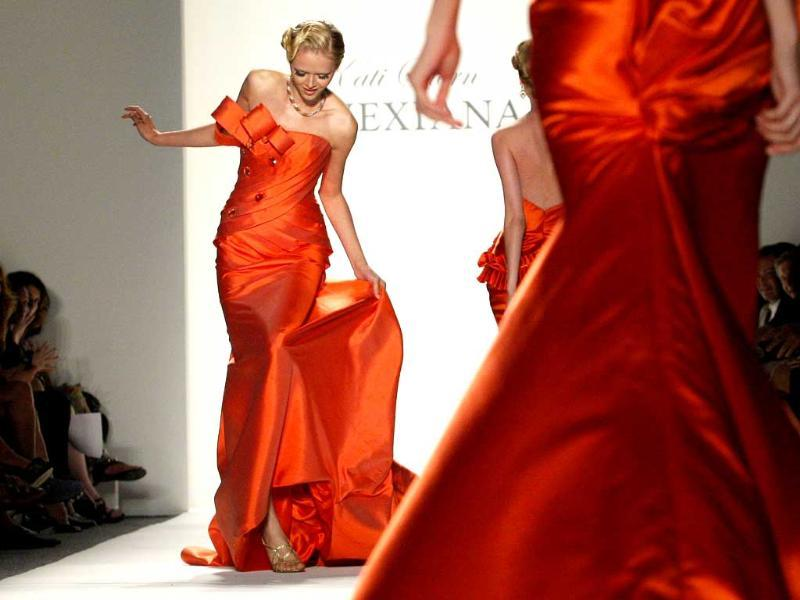A model steps on her dress while presenting a creation from the Venexiana Spring/Summer 2012 collection during New York Fashion Week.