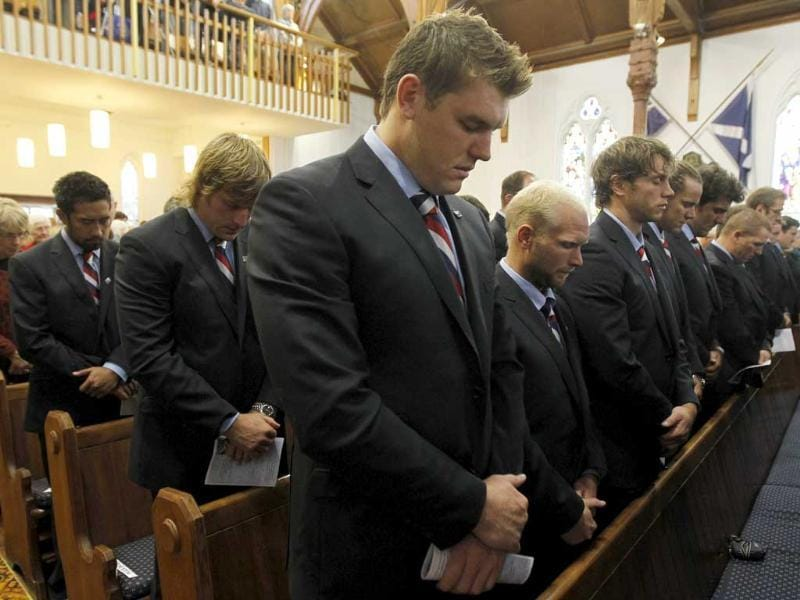 US rugby team players pray during a memorial service to commemorate the victims of the 9/11 terrorist attacks on the 10th anniversary of the attacks at St Andrew's Presbyterian Church in New Plymouth, New Zealand.