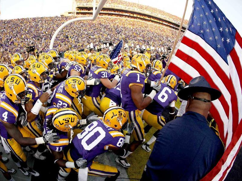 Louisiana State University players run out on to the field waving the US flag in remembrance of the 10-year anniversary of 9/11 before their NCAA football game against Northwestern State in Baton Rouge, Louisiana.