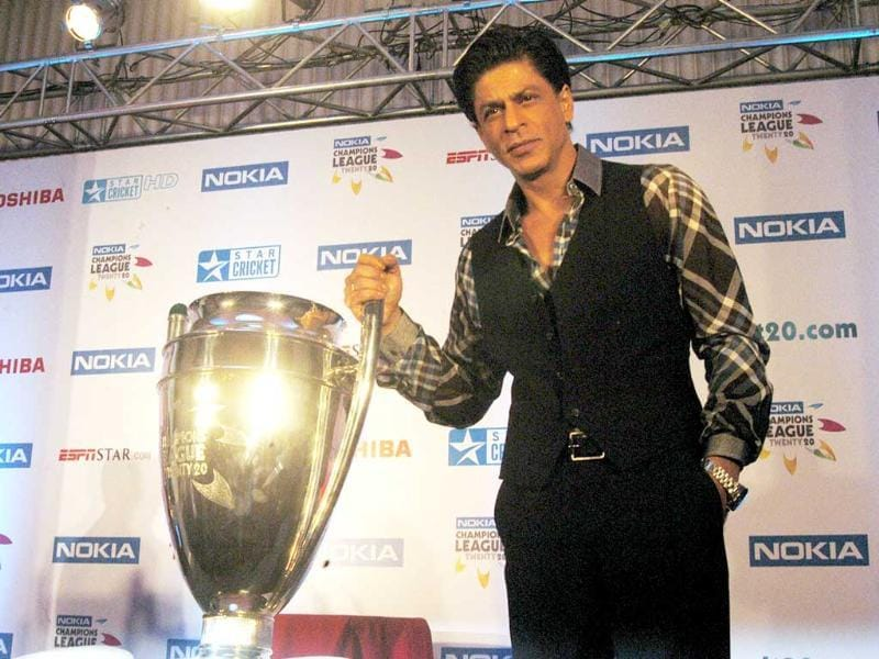 IPL's KKR team owner Shah Rukh Khan unveils the Champions league T20 trophy in Mumbai (PTI)