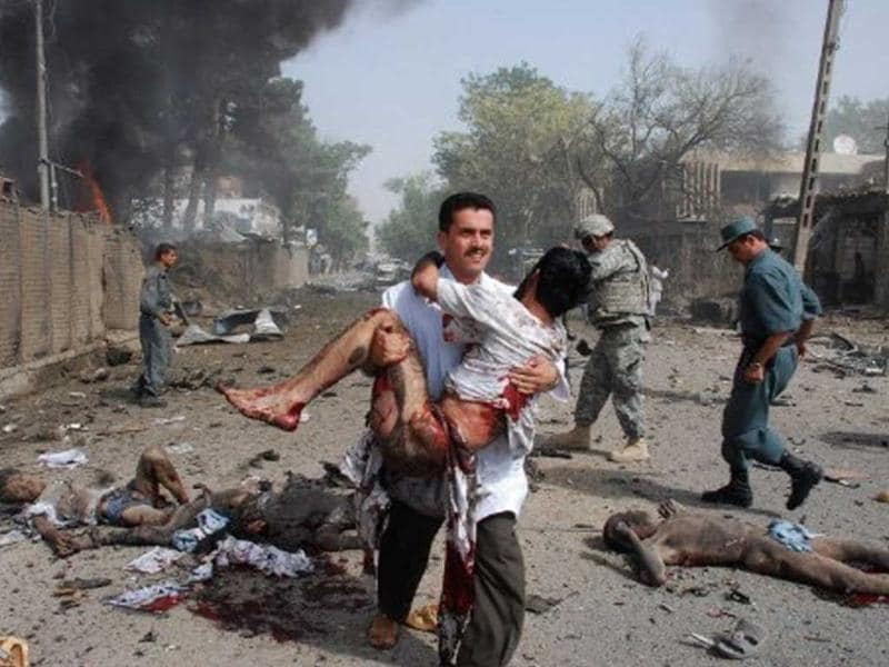 Afghan security force and medical personnel assist survivors as they arrive at the scene of a suicide bombing outside the Indian Embassy in Kabul on July 7, 2008. File photo