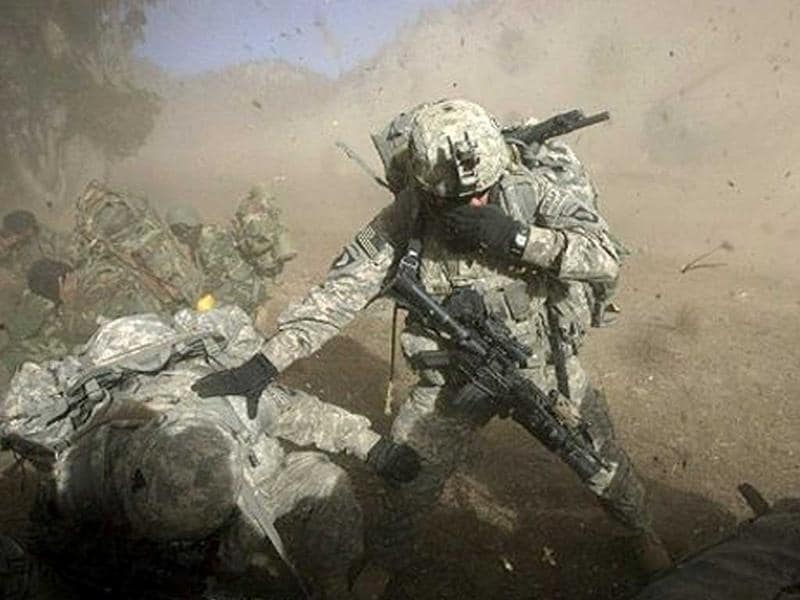 US Army soldiers from 2-506 Infantry 101st Airborne Division and Afghan National Army soldiers take cover from dust and debris on November 15, 2008. File photo