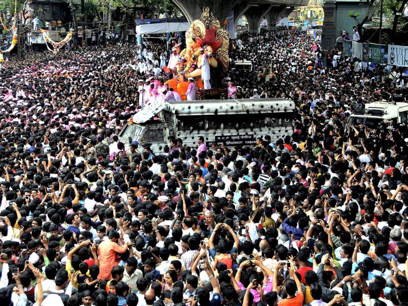 A huge crowd of devotees with Ganesh idol on the way for immersion at Girgaum Chowpatty at the end of the ten day long Ganesh festival, in Mumbai.