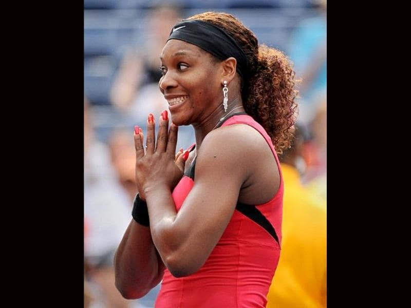 Serena Williams of the US makes a face during an interview after her 6-0, 6-1 win over Michaella Krajicek of Netherlands during a women's single match at the US Open tennis tournament at the Billie Jean King National Tennis Center in New York.
